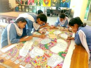 Students working on a banner for the CLF