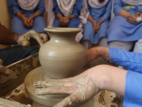 Students at the wheel during pottery club