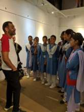 Imran Qureshi gives students a talk about his art