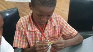 Anathi concentrating during robotics