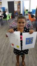 Andrey with her drawing from Elbi