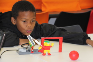 Denzil with the Lego robot he built and programmed