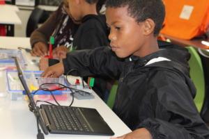 Denzil programming his Lego robot