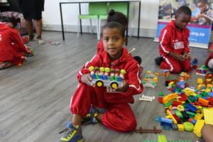 Shameeg with the school bus he built