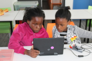 Creating the programme for their robot