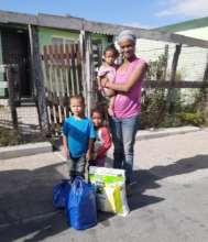 A family in Manenberg receiving food