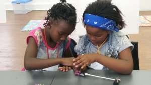 Phozisa and her friend working with LittleBits