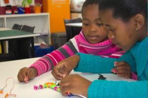 Thandi* and Bongi* working with LittleBits