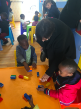 ORT SA CAPE's director, Lydia, with the children