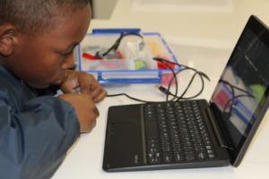 Wadeley programming his Lego robot