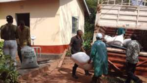 DNRC staff loading moringa seeds