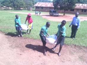 Pupils help to lift the flour