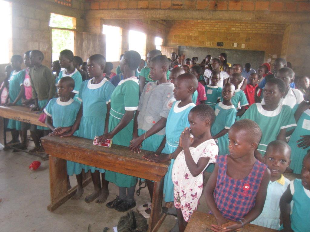 Provide school uniforms to 100 pupils in Uganda