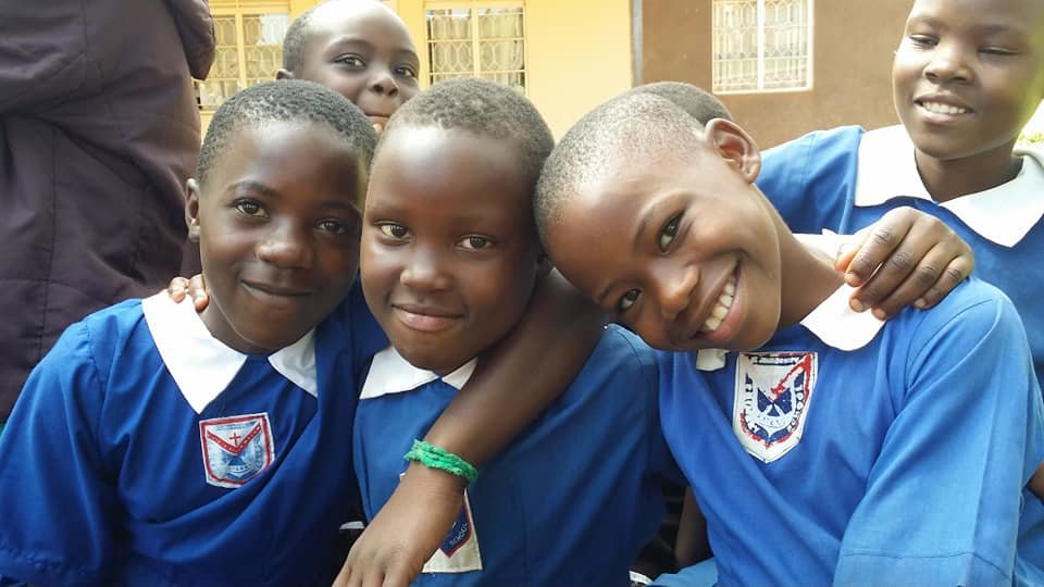 Provide school uniforms to 100 pupils in Uganda