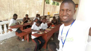 Martin with students during the meal program