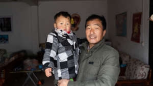 Kaikai and his grandfather share a moment.