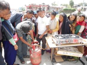 Demonstrating an LPG cooking stove to Khasi women