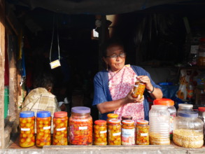 Drasmina in her shop selling tea and pickles