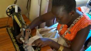 Beneficiary at the dressmaking class