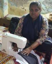 Halima with her sewing machine