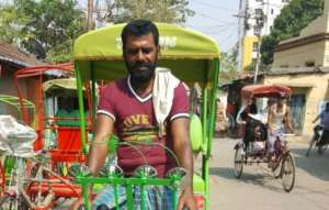 Ujala's Father with his new rickshaw
