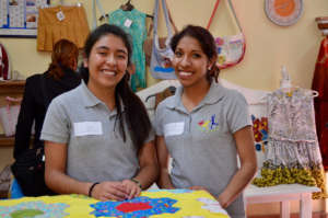 Laura and Juana with quilt