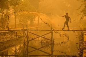 Man fishing in yellow toxic air