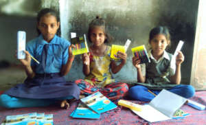 Distributing educational materials to needy child