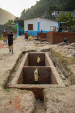 The septic with new toilets and classrooms behind