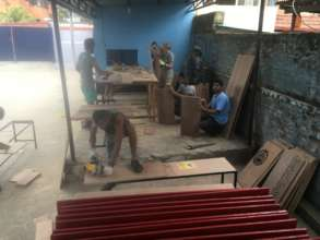 Now we're building furniture for the classrooms