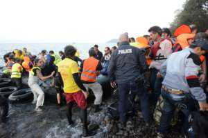 Refugees Arriving on a Raft in Lesvos, Greece