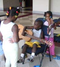 Homeless children in a shelter receive GITC music