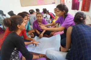 Girls discuss their peer meetings