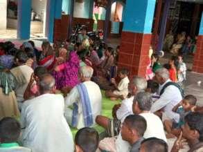 Community members attending the program