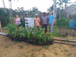 Edivaldo, family and friends receiving seedlings