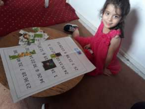 Little girl working on edu-kit