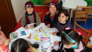 Syrian Refugee Children using the education kits