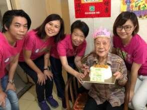 Celebrating Yee Gu's 100th birthday at her flat