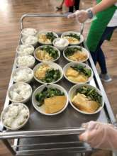 Hot meals served on food trolley at the Centre