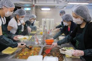 Volunteers preparing hot meals in the kitchen