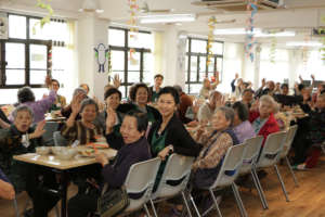 Elderly members having lunch in community centre
