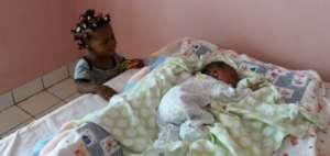 Rita admiring new baby