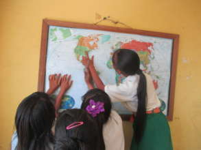 Students enjoying their new world map