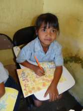 Primary school girl proud of her art work