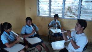 Primary school children practice recorder in music