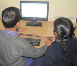 Children learning computers at AWC