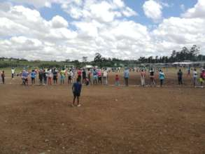 Adolescent  Girls and Young Moms playing football