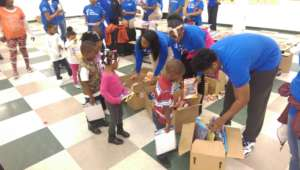 TYC Youth Passing out Toys and Books in Flint.
