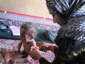 Child and health worker in Afghanistan