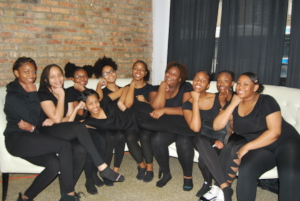 Girls pose prior to a performance